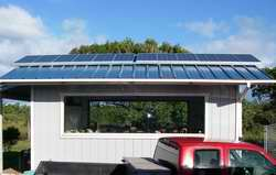 Off grid home in Huelo, tool shed with 12 photovoltaic panels on roof